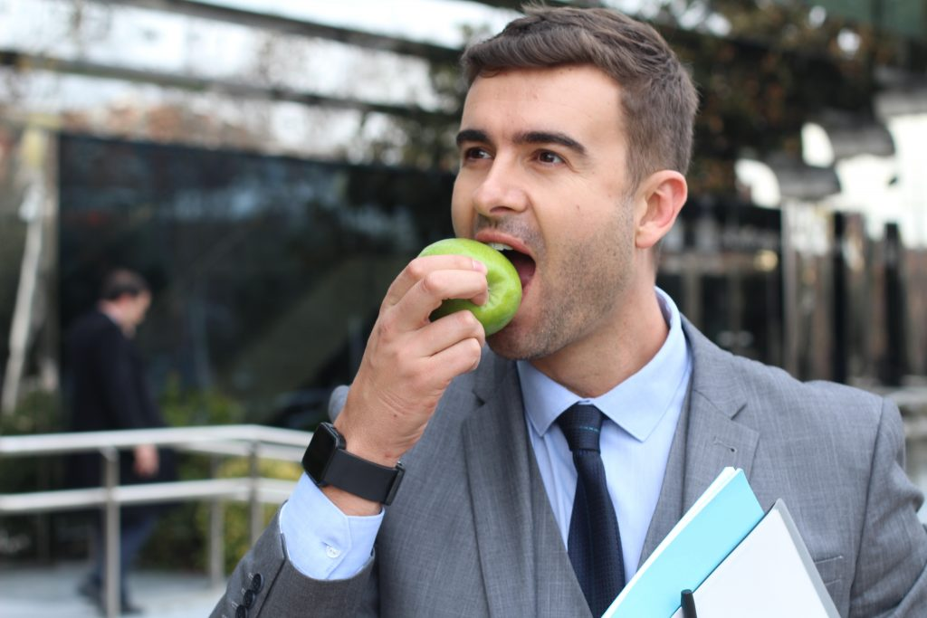 Busy businessman eating healthy on the go