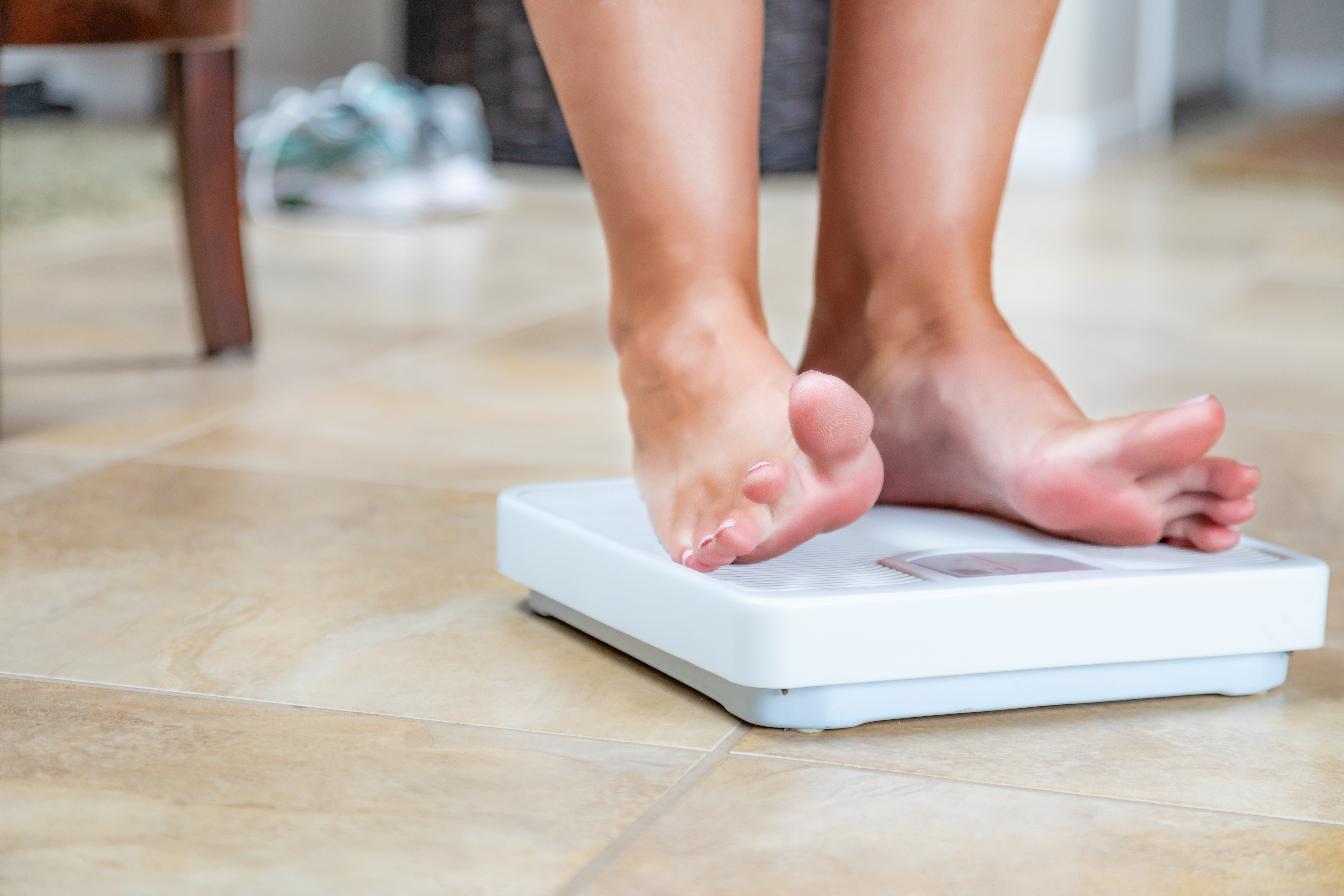 woman who lost weight weighing herself