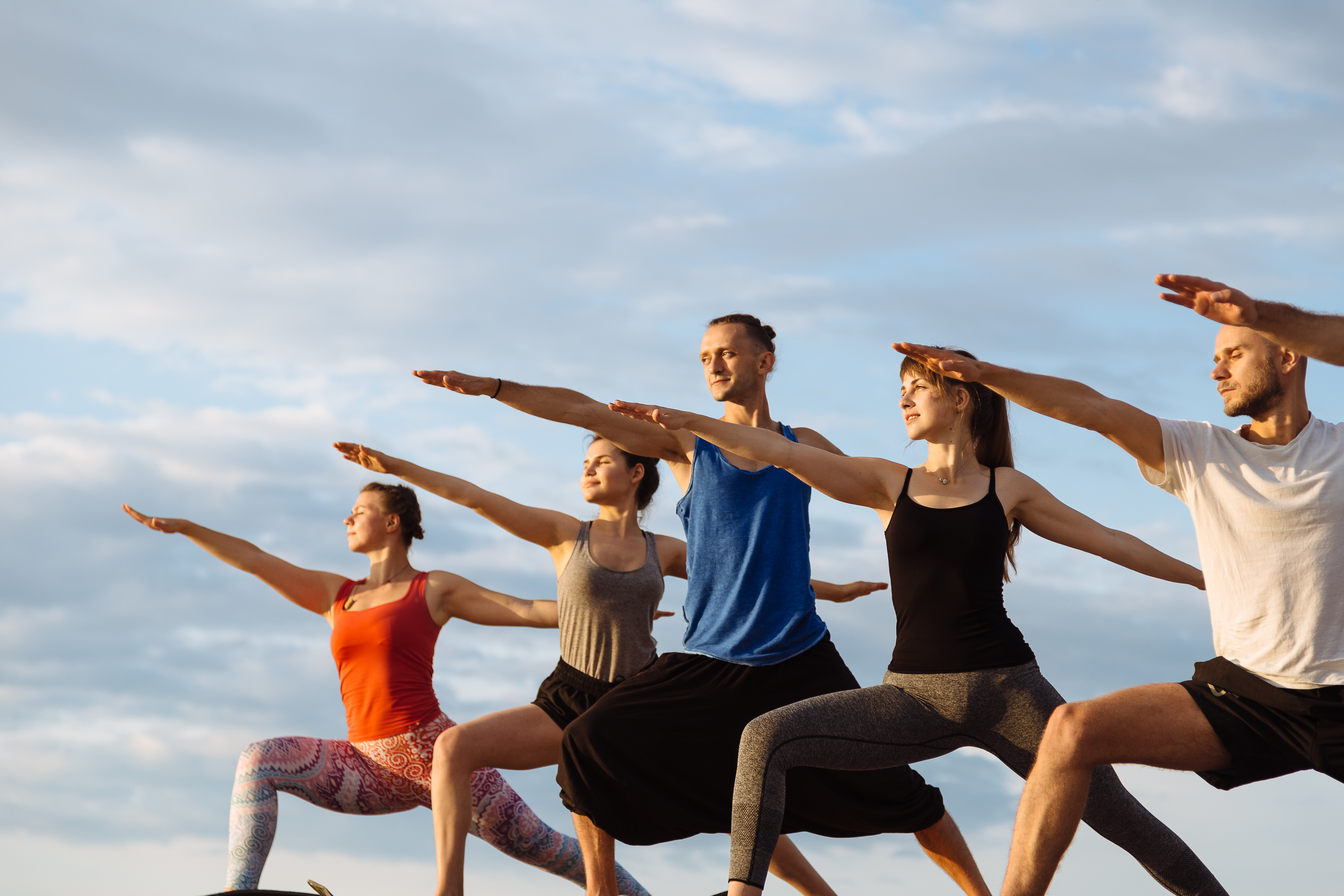 a group of people exercising to reduce stress