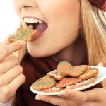 woman eating holiday cookies