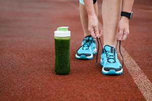 women lacing up shoes to start running again for weight loss