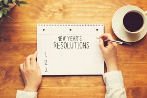 notebook with blank list for new year's resolutions