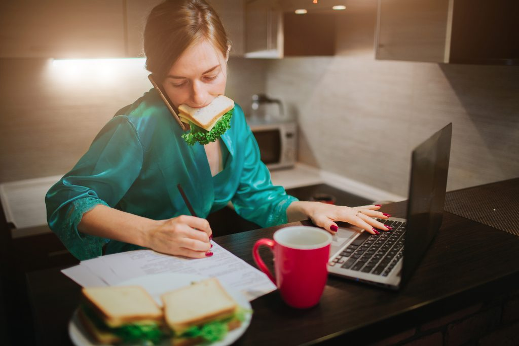 busy woman multitasking at desk