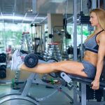 woman working out her lower body at the gym