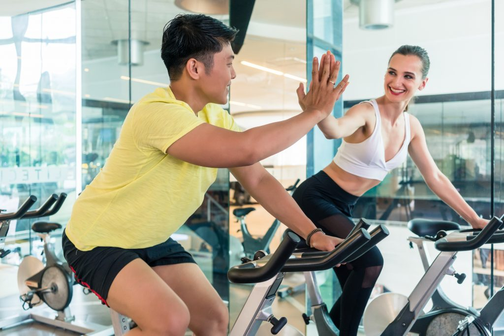 workout partners high fiving.