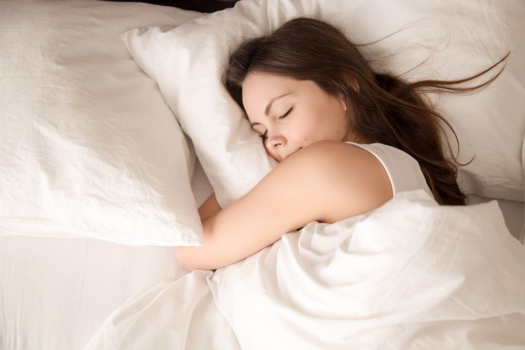 woman sleeping soundly after exercising